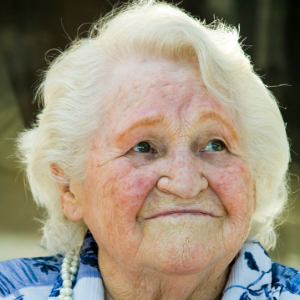 older woman looking off to the side and smiling